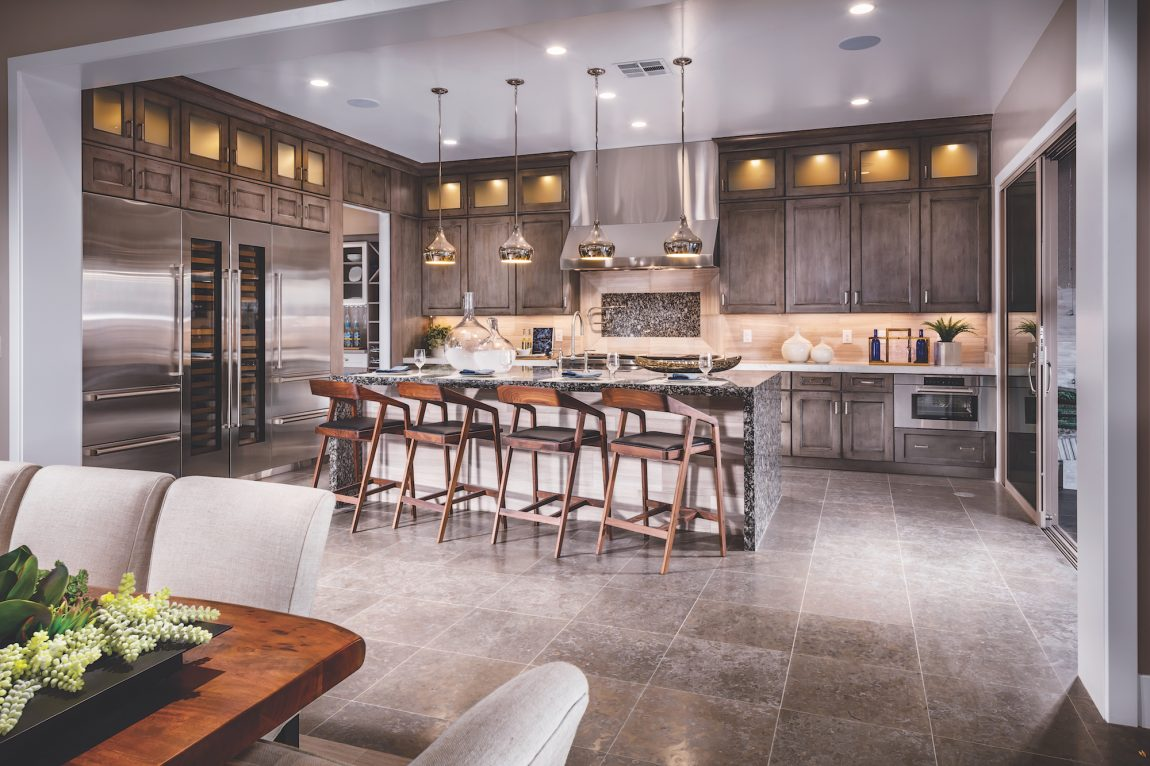 Large kitchen design with stacked cabinets.