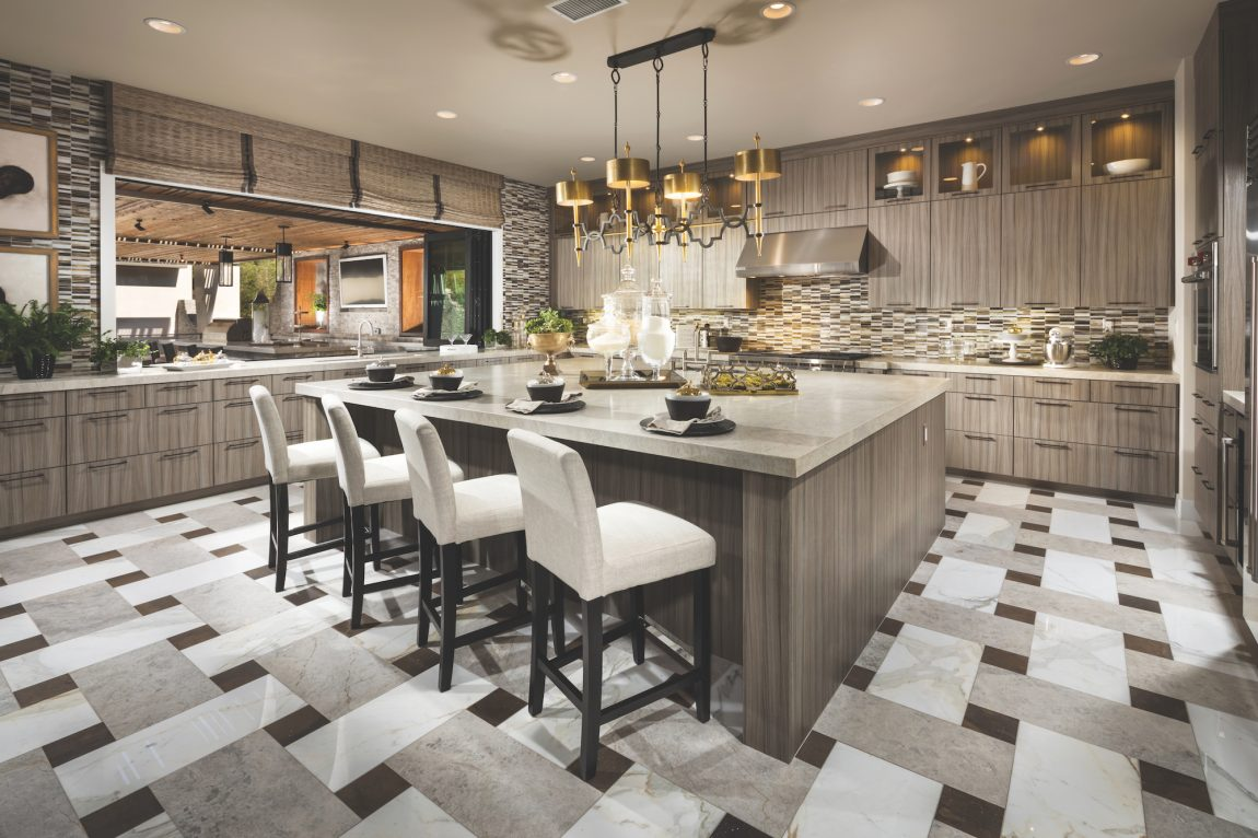 Kitchen with patterned tile floor.