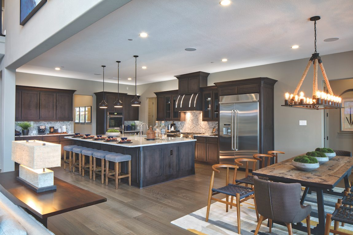 Rustic Kitchen with Wood Hood Range & Dining Room