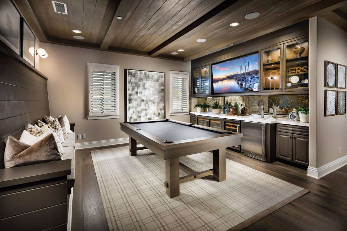 Game room with a tv and a pool table.