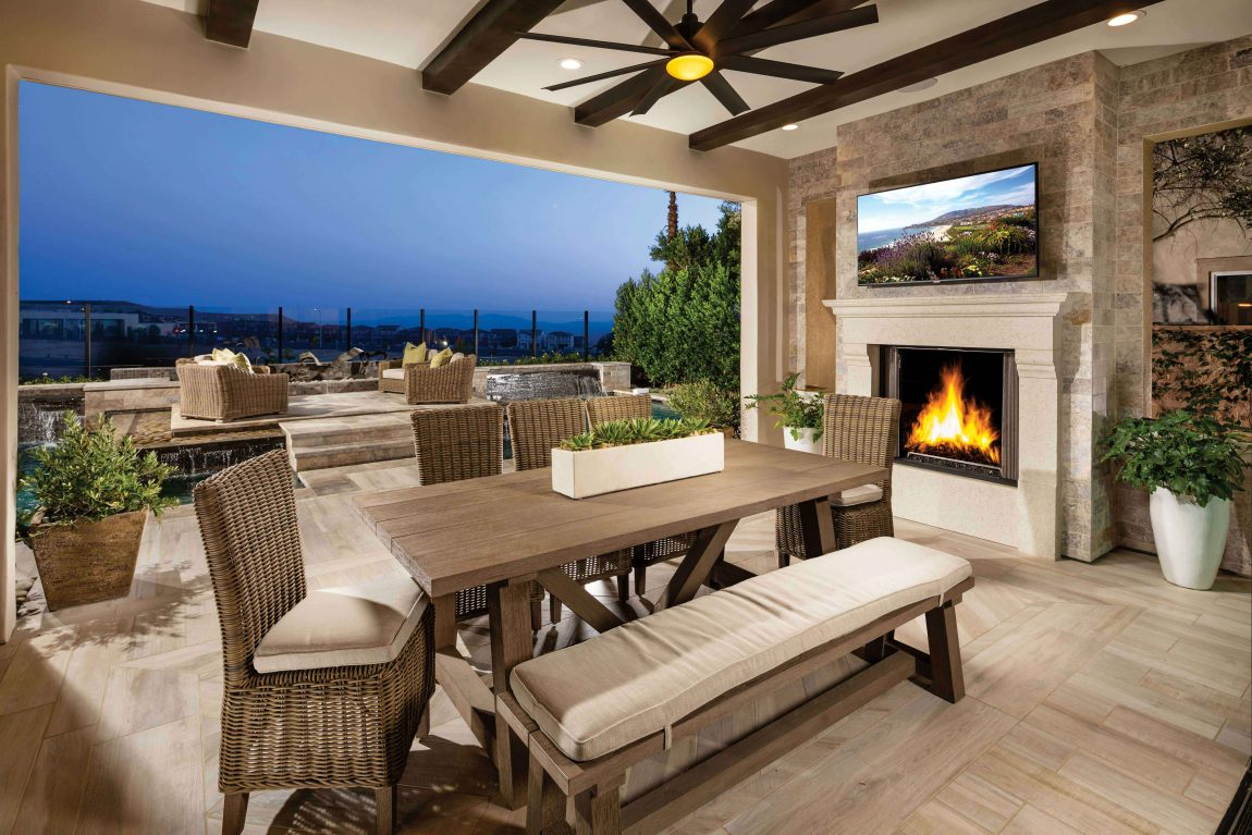 Patio with fireplace and a tv.