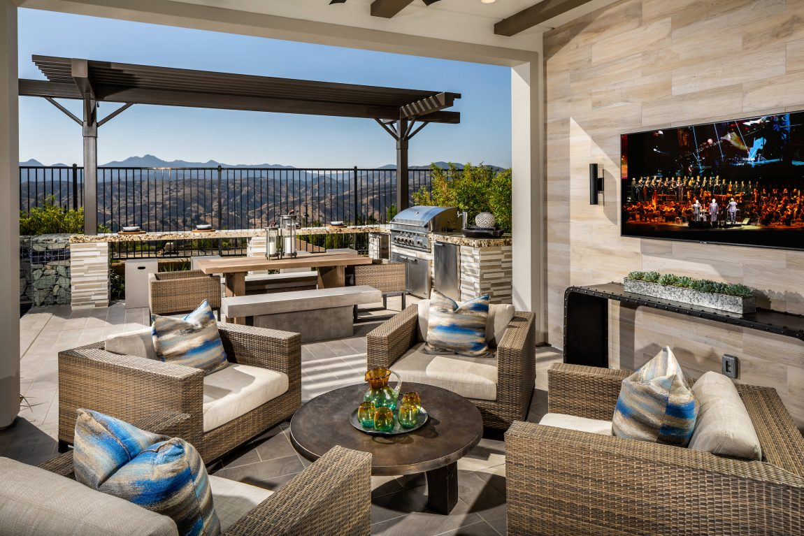 Patio with a grill at a tv.