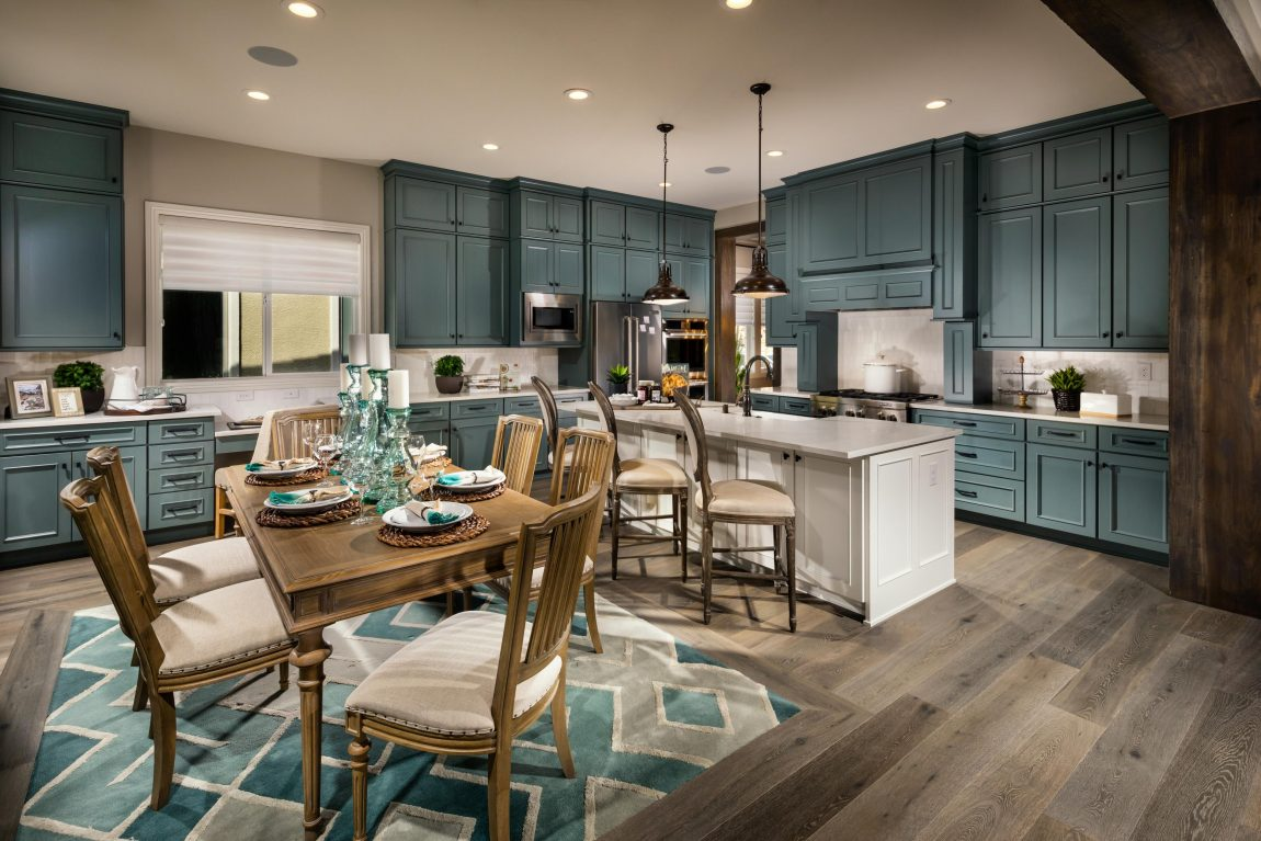 Luxury Kitchen with Teal Cabinets & Blue Accents