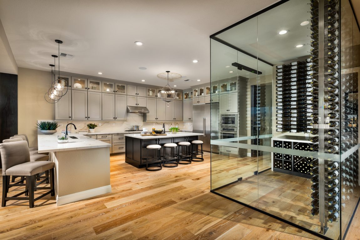 Large Gourmet Kitchen with Luxurious Glass Display for Wine
