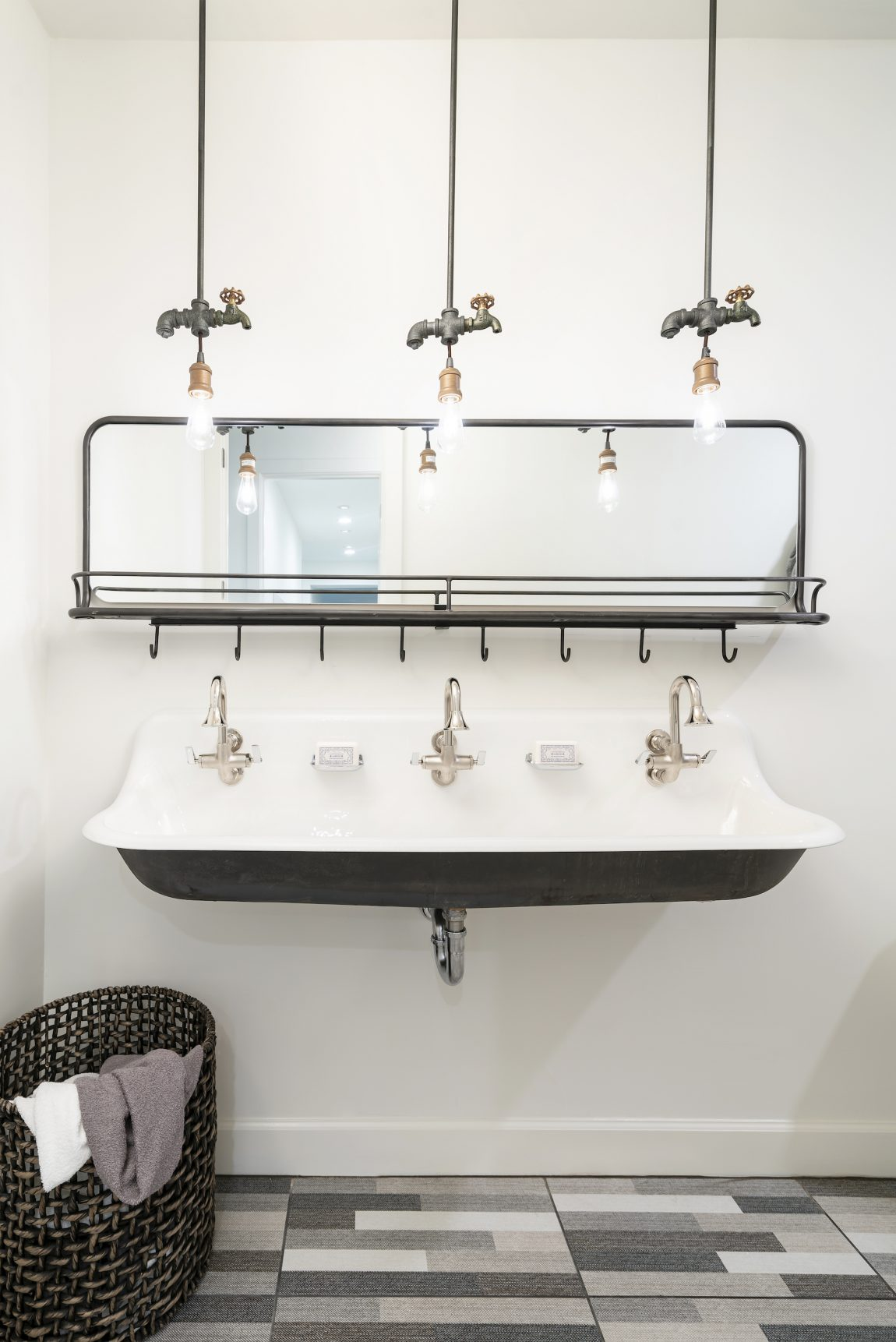 Sink with industrial fixtures and lighting.