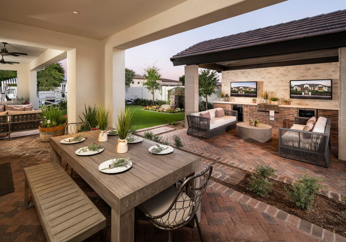 Backyard and patio with tv and seating areas.