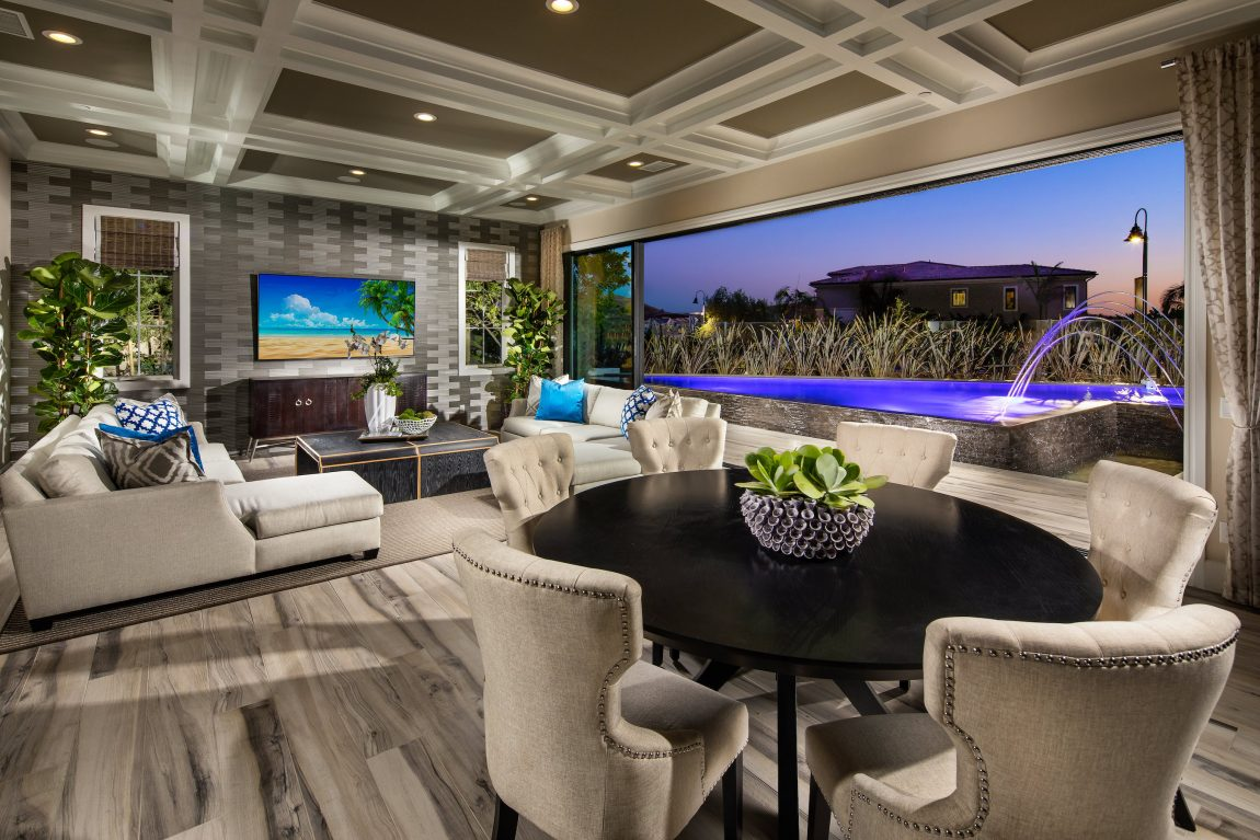Living room with large opening to backyard with a fountain.
