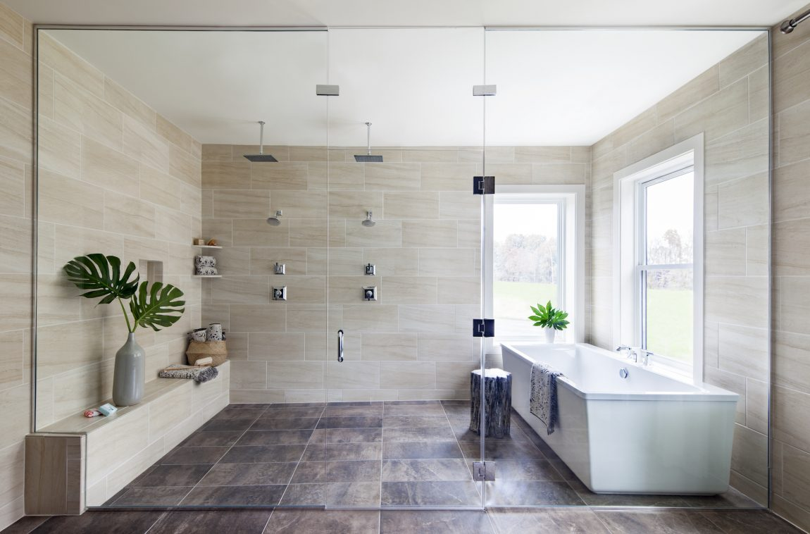 Modern bathroom with a large shower and rain head fixtures.
