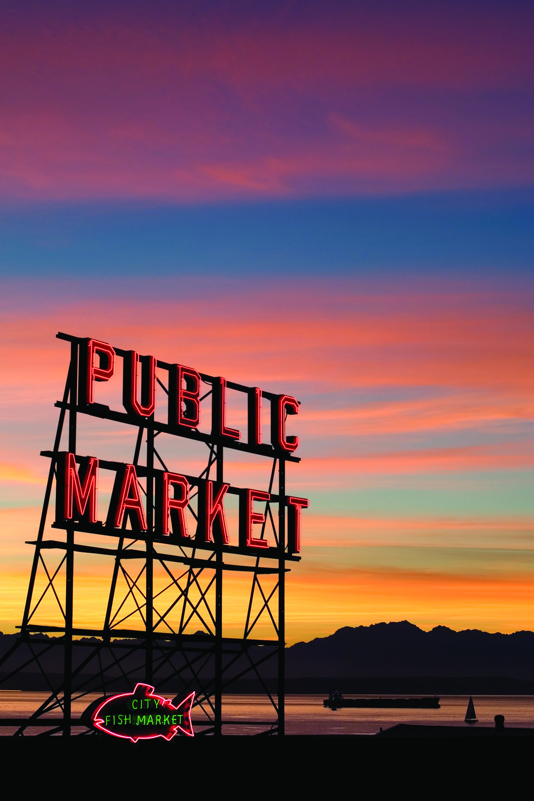 Public Market red neon sign at sunset
