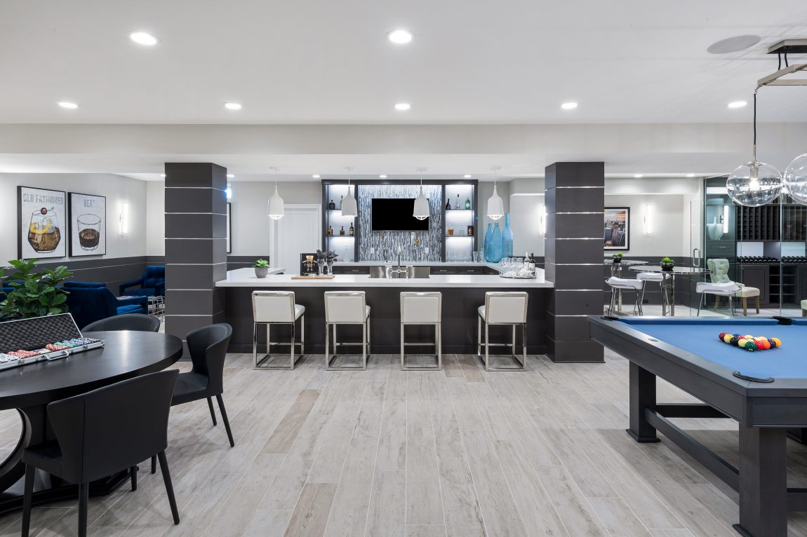 Basement with a bar and game room
