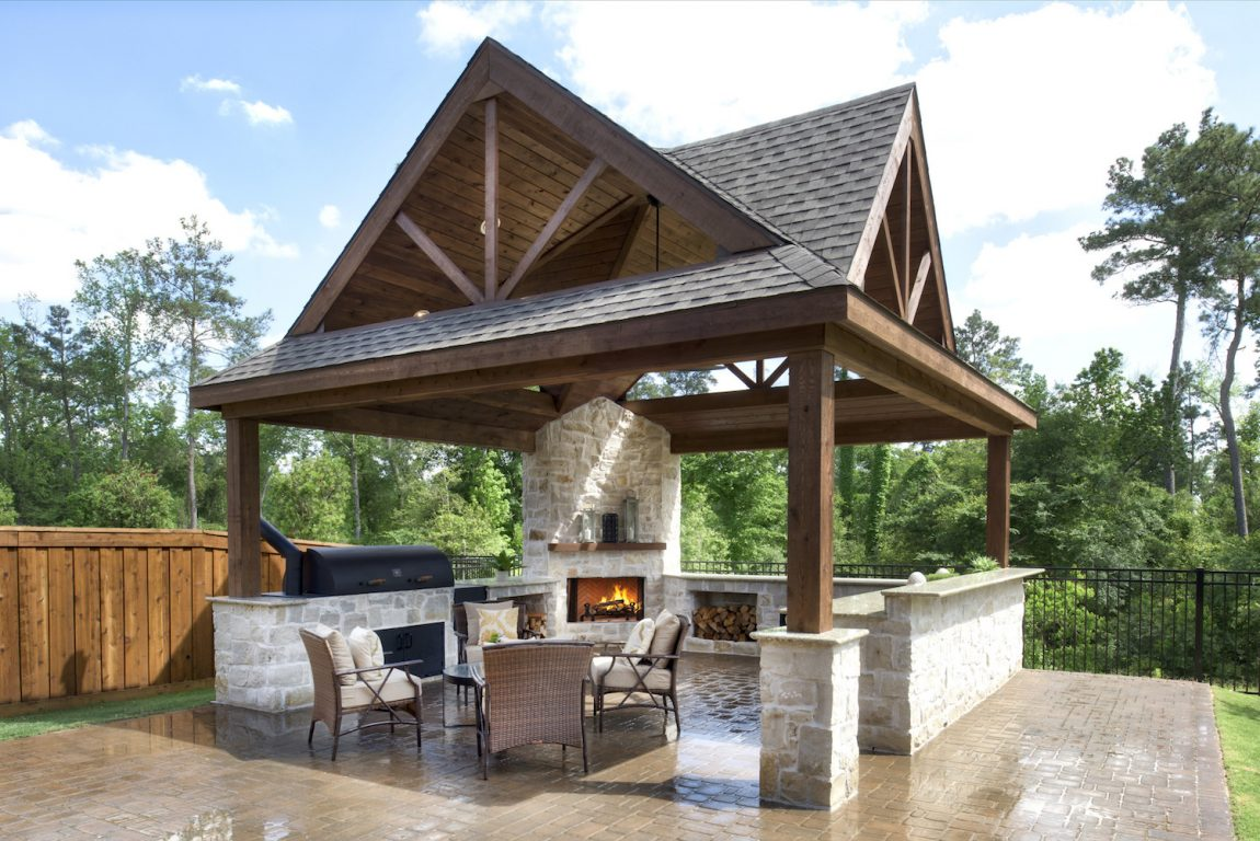 Outdoor kitchen with seating area and furnace