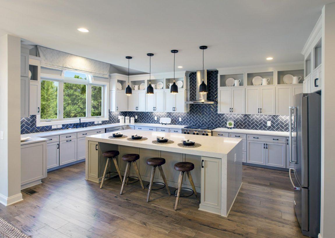 Kitchen with herringbone pattern backsplash.