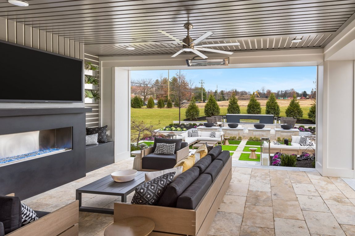 Outdoor patio with tv leading to a backyard.
