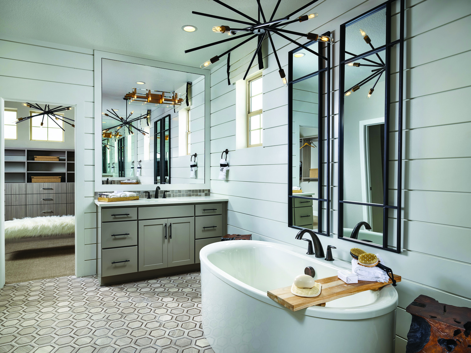Bathroom with a stand-alone bathtub and shiplap walls.