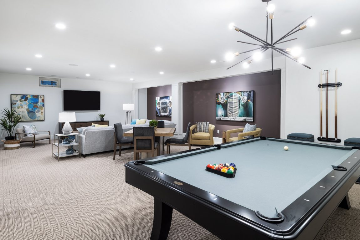 Basement with a pool table.