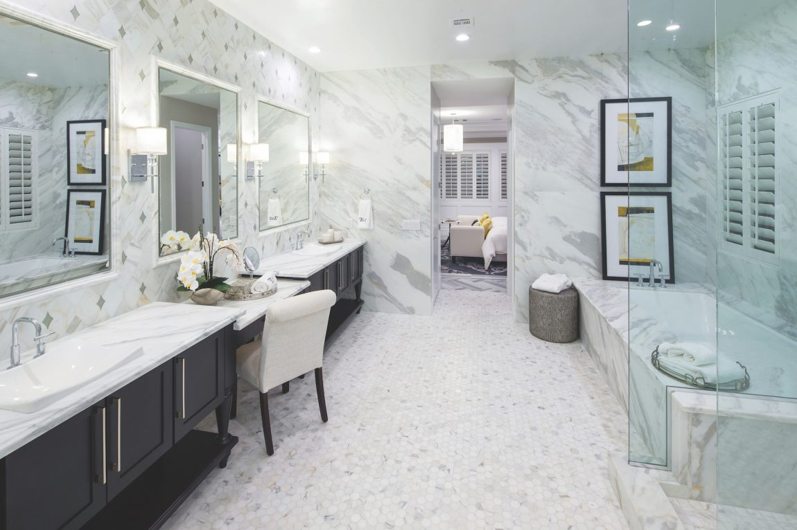 All-White Bathroom with Black Cabinets and Clean Lines