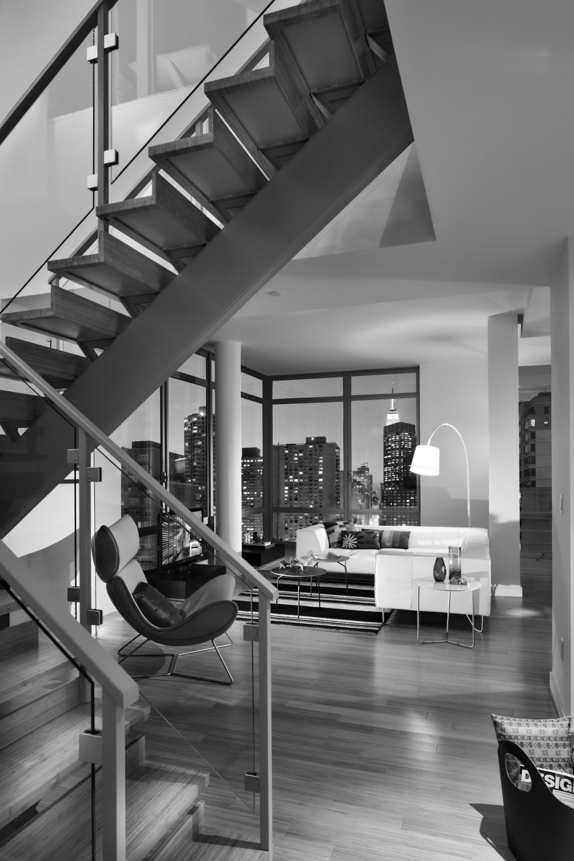 A staircase, living room, and view of New York City.