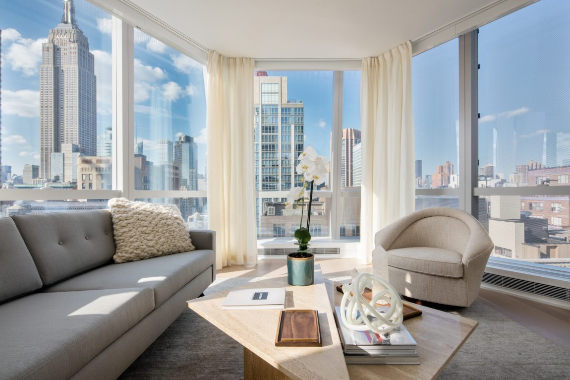 A cozy space with glass walls and a view of the city