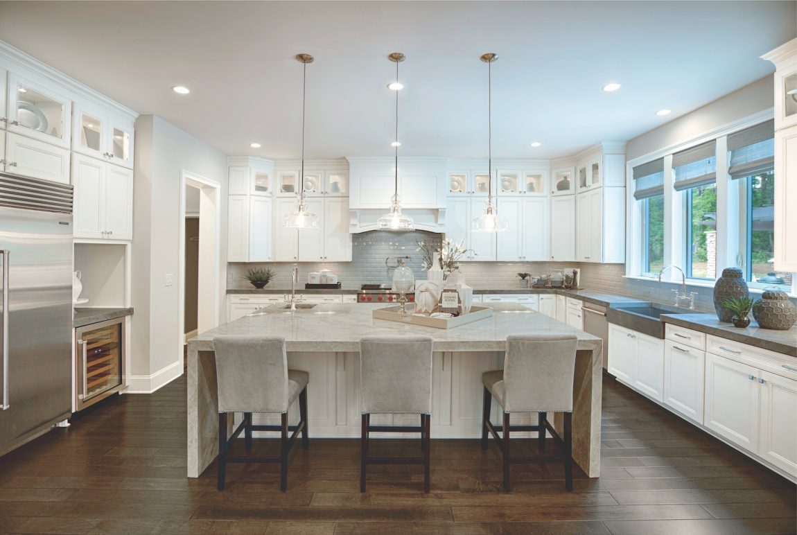 White kitchen with island and pendant fixtures