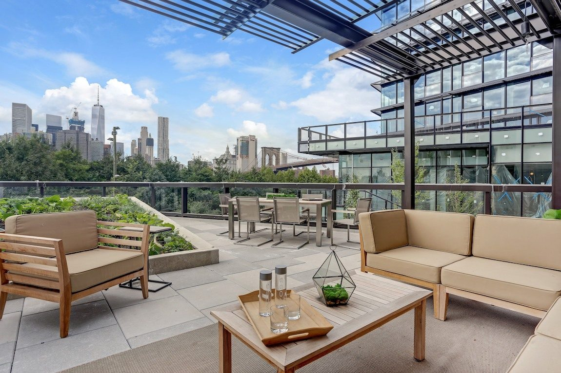 Outdoor seating area with city views.