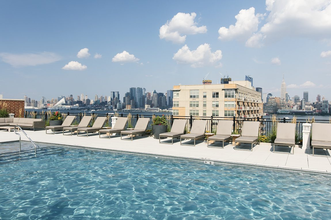City living roof top pool and city view