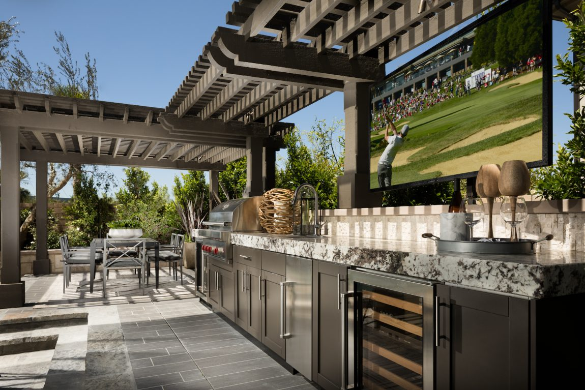 Outdoor kitchen area with pergola.