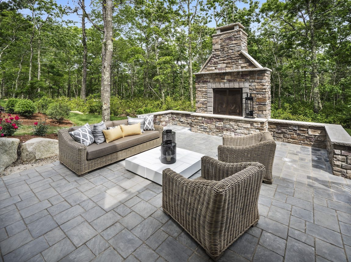 Outdoor fireplace with seating area.