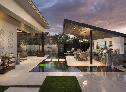 Backyard bar in an outdoor living space of suburban home