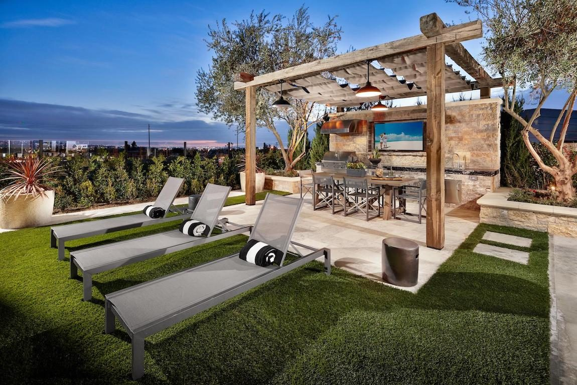 Sunbathing spot with bar area and outdoor television.