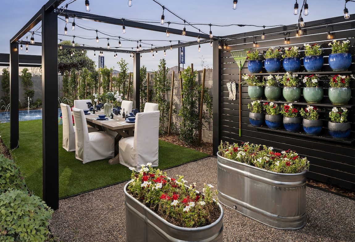 outdoor dining area with hanging plants and flowers.
