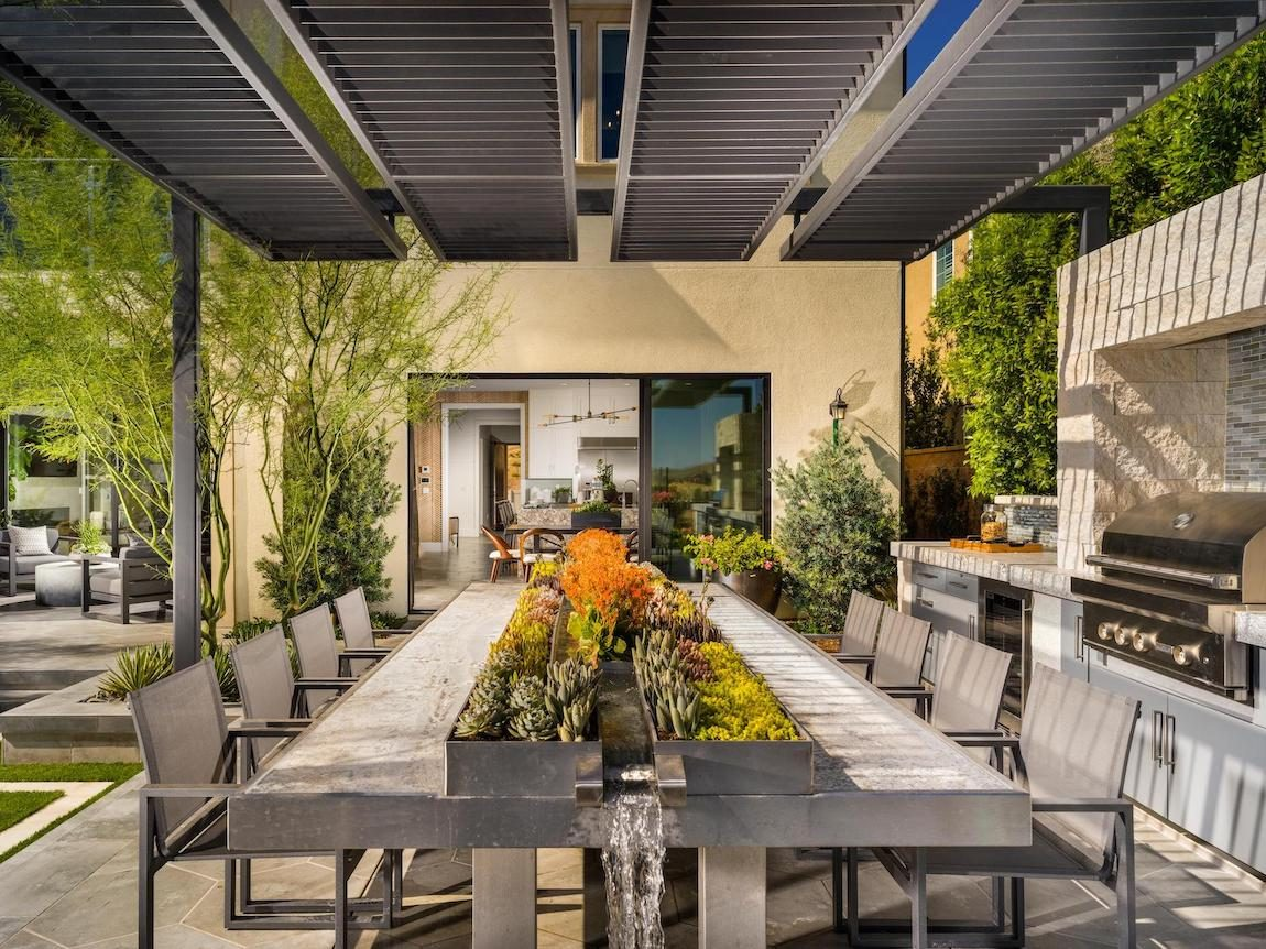 Outdoor dining area in backyard.
