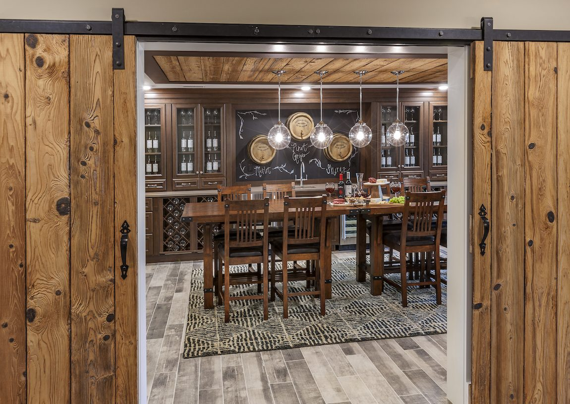 Wine room with wooden table perfect for a tasting area