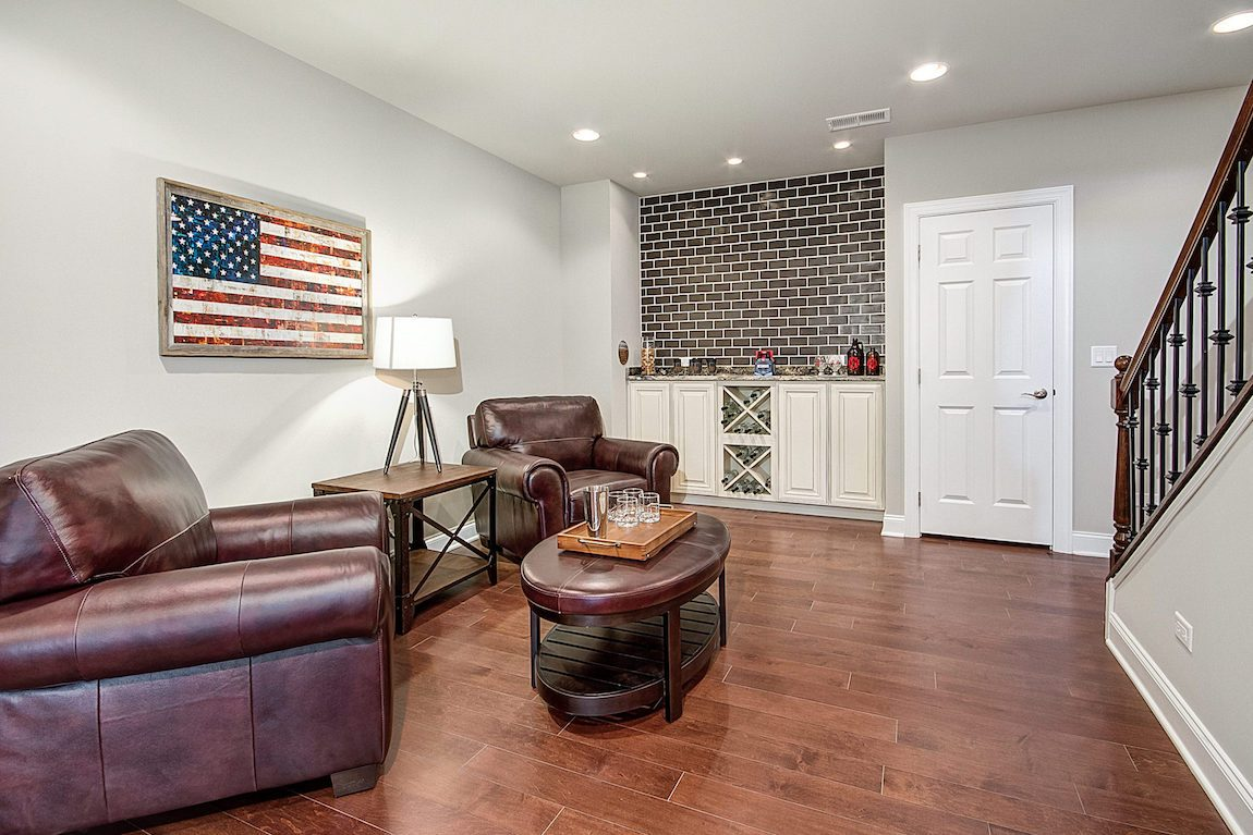 Basement area with comfy couches and American flag