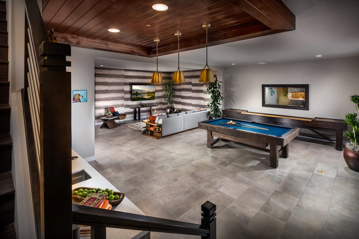 Contemporary basement design with pool table, entertainment area and bar.