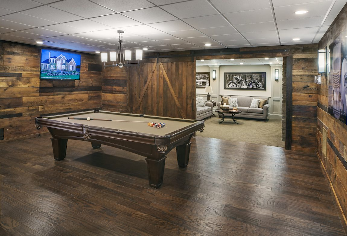 Basement with modern farmhouse design and pool table.
