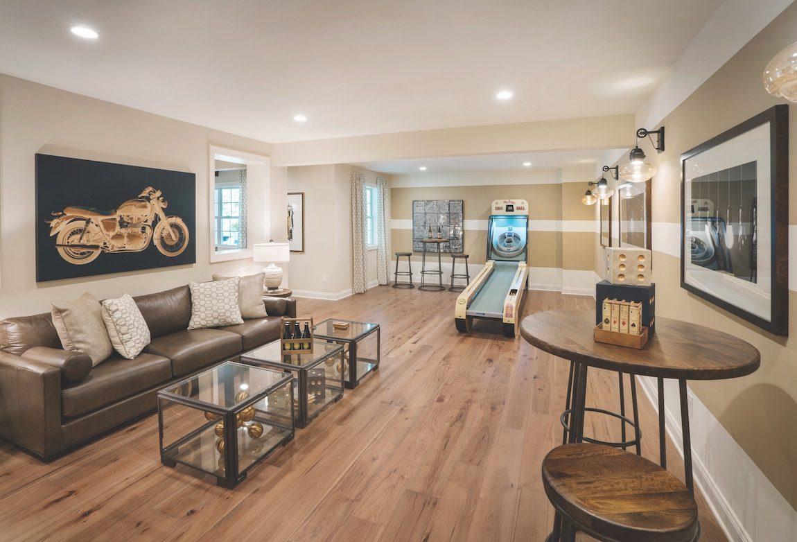 Basement entertainment area with hardwood floors.