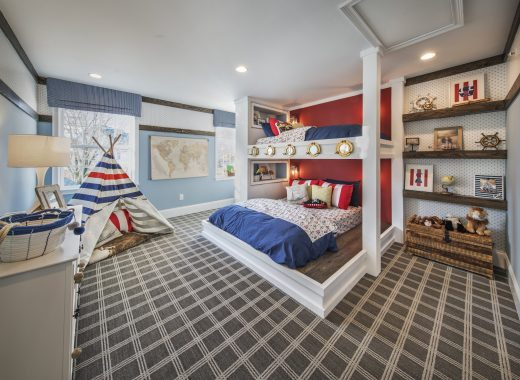 Inspiring kids bedroom featuring innovative bunk bed and geometric carpeting.