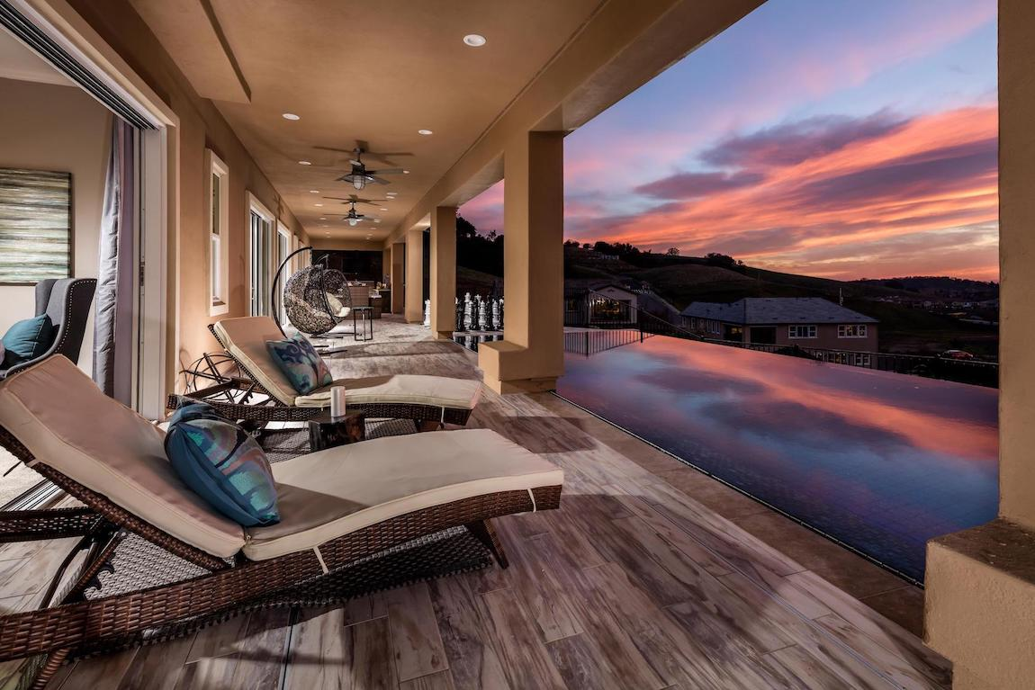 Lap pool with a view of the sunset.