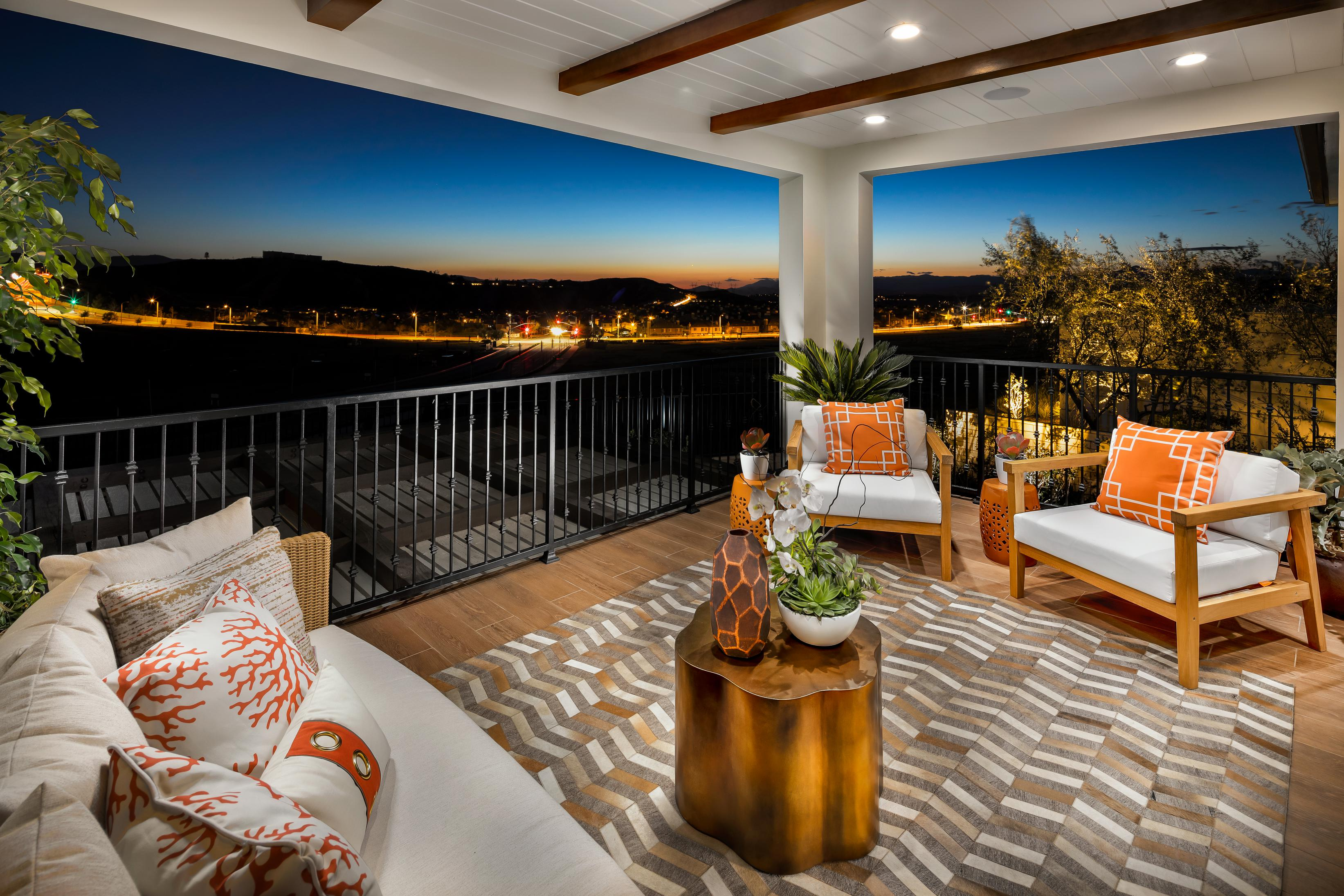 Breathtaking outdoor living area with comfortable seating and panoramic view of the surrounding environment.