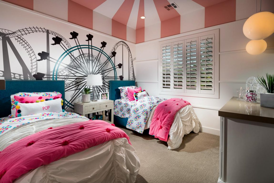 Shared kids room featuring imaginative amusement park theme.