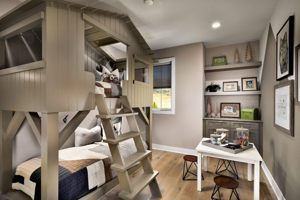 Kids bedroom highlighted by creative bunk bed and arts-and-crafts station.