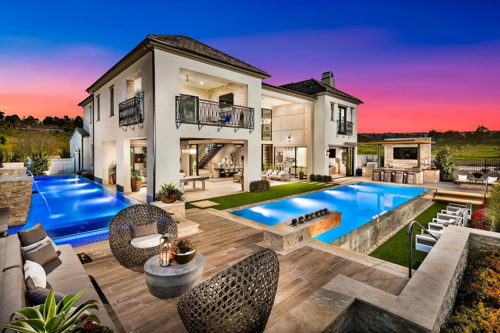 Vast backyard with sitting area, pool, bar and outdoor living space.