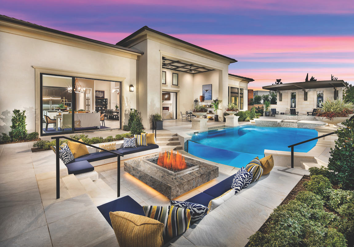 Backyard with outdoor pool, fire pit and sitting area.