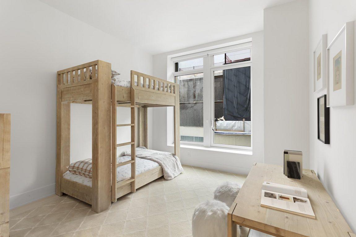 Simple yet elegant kids bedroom featuring wooden bunk bed.