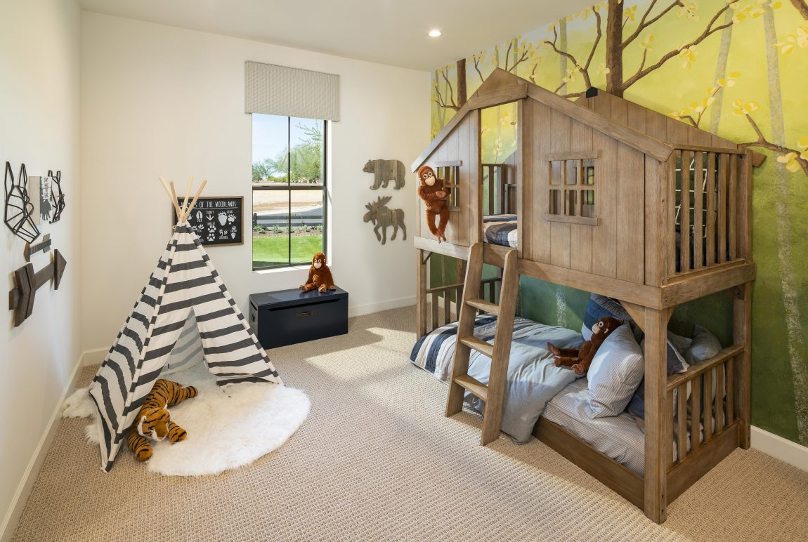 Creative kids bedroom featuring treehouse style bunkbed and jungle theme.
