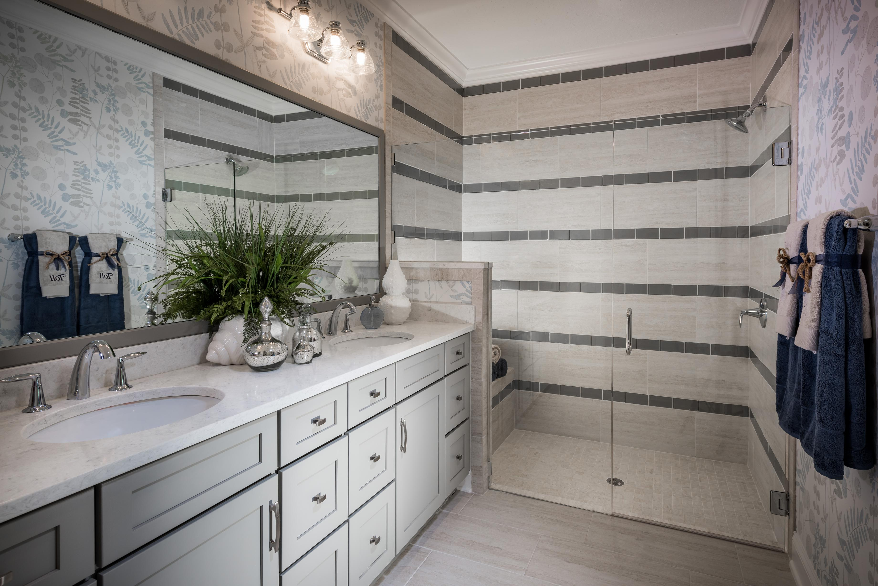 Vanity and walk-in shower with horizontal tiling
