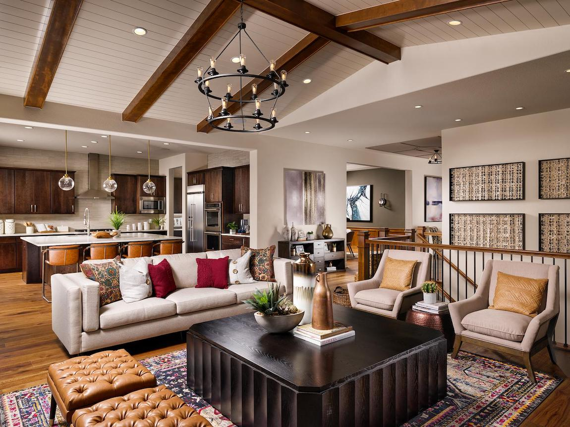 Family room with wooden beamed ceilings and red accent pillows.