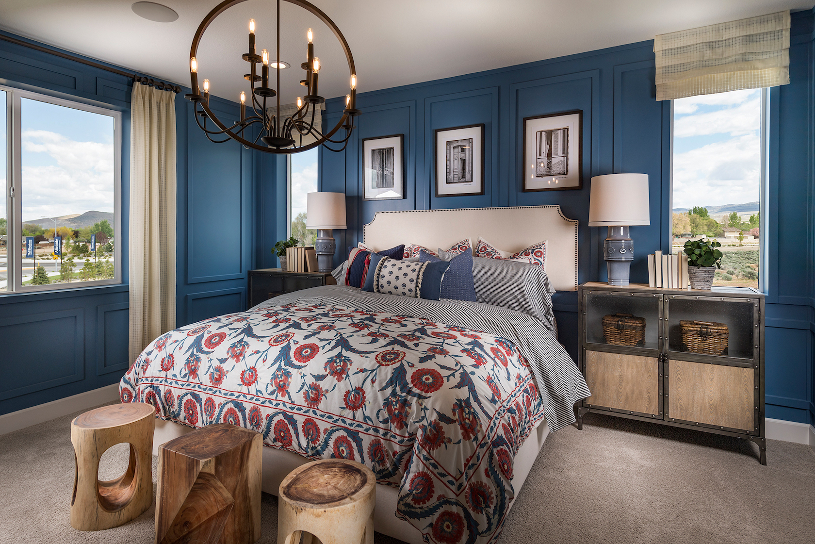 Bedroom with blue painted walls and modern chandelier.