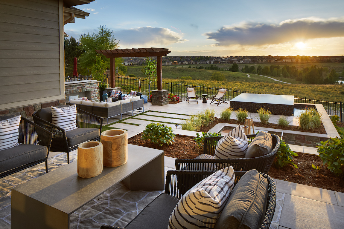 Backyard with a view, fireplace, seating area and landscaping.
