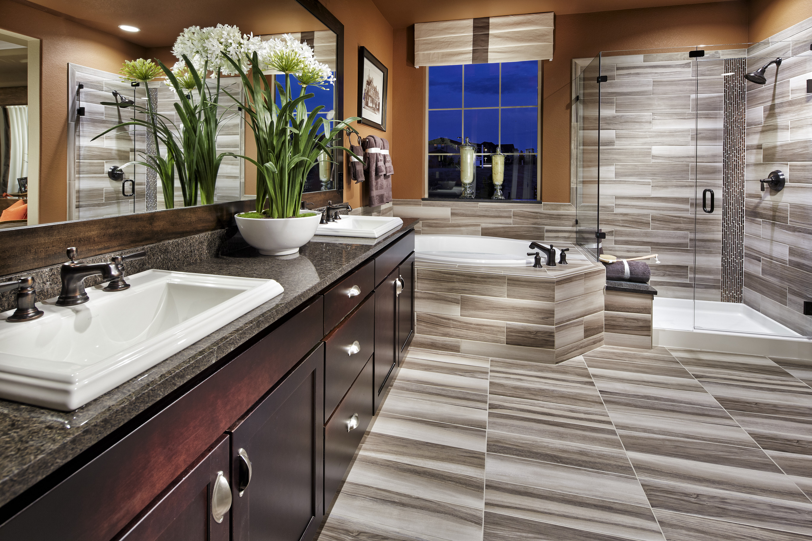 Vibrant bathroom with multicolored floor and siding tiles.